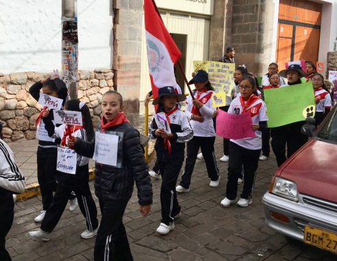 School girls demonstrating against corruption in Cuzco Peru